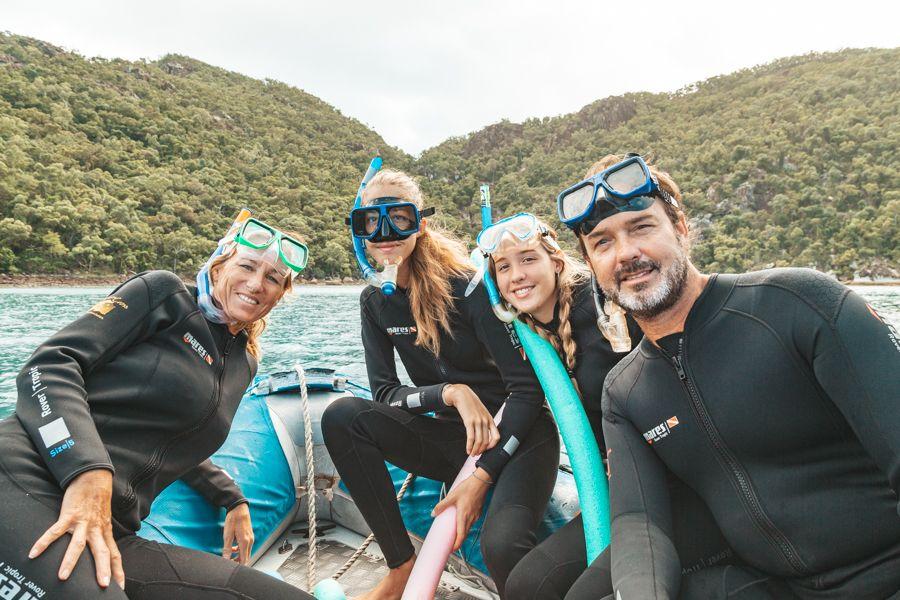 Family with stinger suit, Whitsundays, Australia
