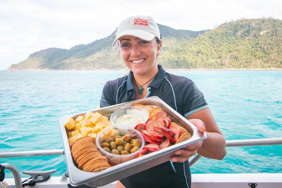Whitsunday Bullet Girl Serving Food Whitehaven Beach