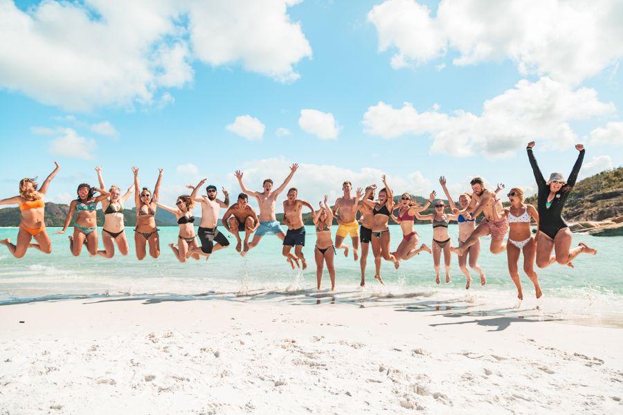 Backpacker Jump Whitehaven Beach Whitsundays