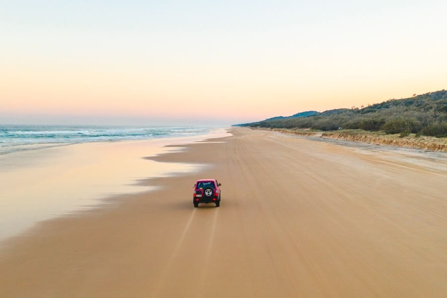 Driving on 75 Mile Beach at Sunset, Fraser Island