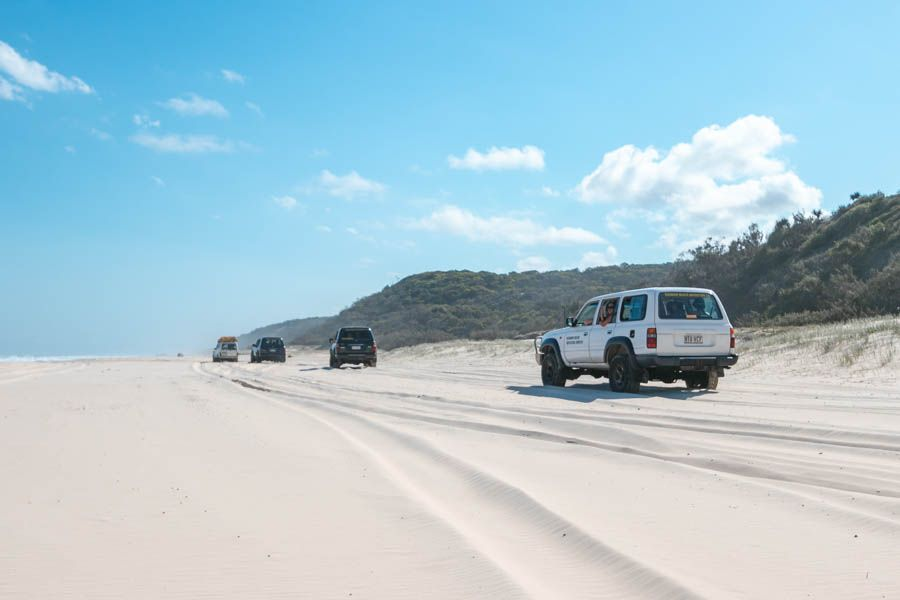 Tag-Along Tours driving on the soft sand of 75 Mile Beach, Fraser Island Queensland