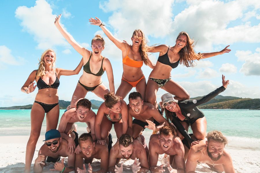 backpackers on whitehaven beach