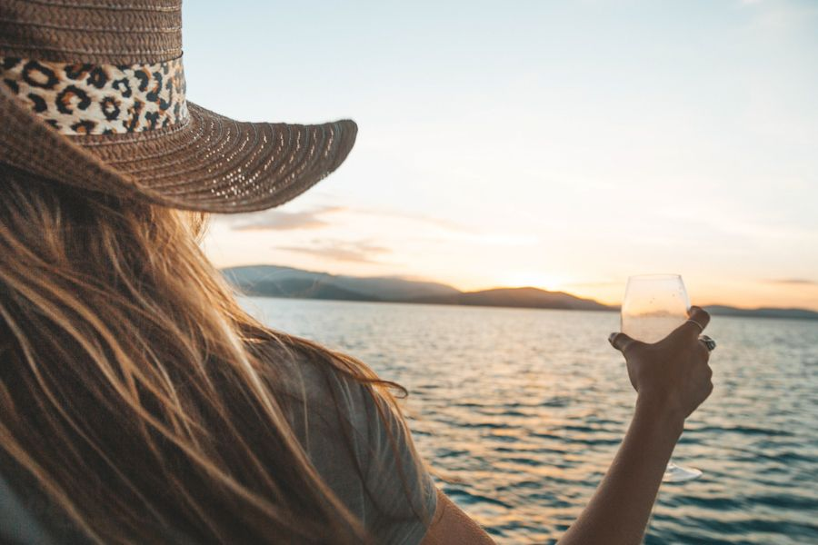 girl drinking wine on bow of boat in whitsundays