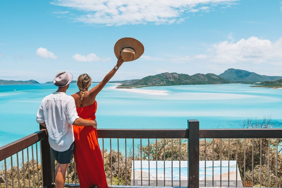 people standing at the lookout at hill inlet