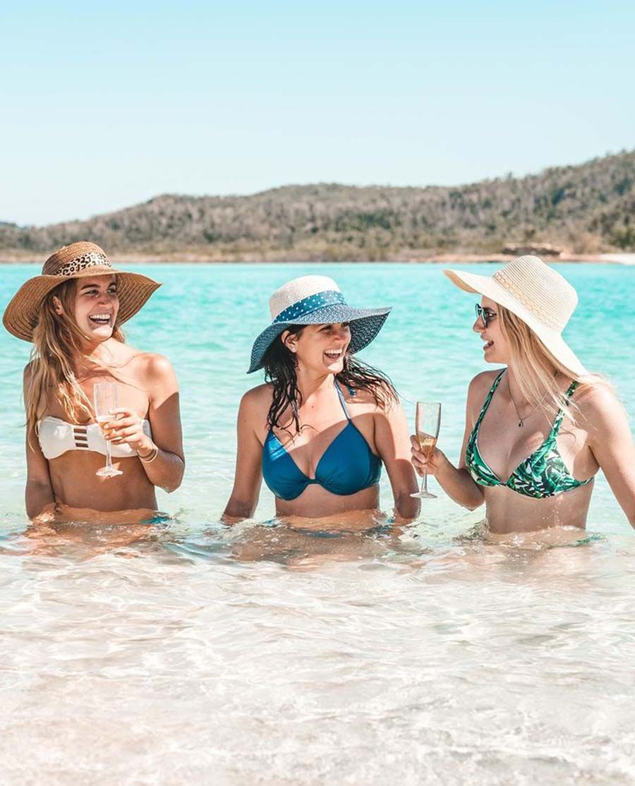 Whitehaven Beach Girls Drinking Champagne in the Sun, Instagram, Whitsunday Island, Whitsunday Catamarans