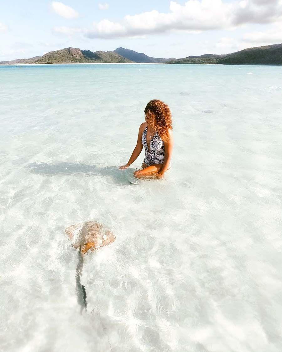 Whitehaven Beach Girl Swimming with Stingrays, Whitsunday Island