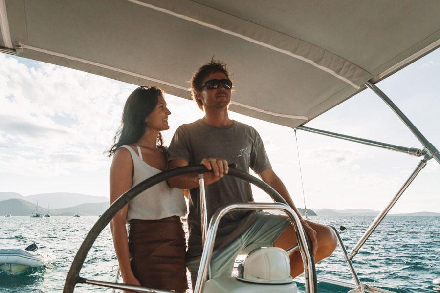 driving a boat, sailing whitsundays, whitsundays