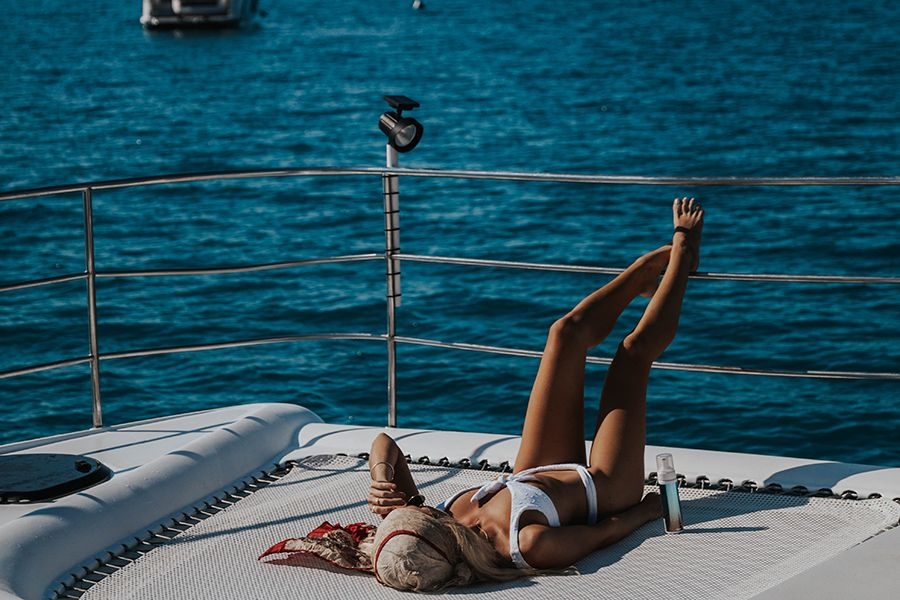 Abbie-Influencer Whitsunday tanning Powerplay luxury Catamaran