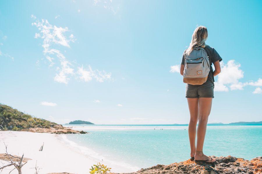 backpacker on whitehaven beach