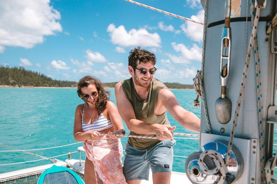 Entice Catamaran couple sailing the Whitsundays