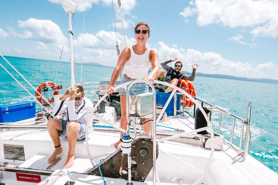 Woman sailing in the Whitsundays, Australia