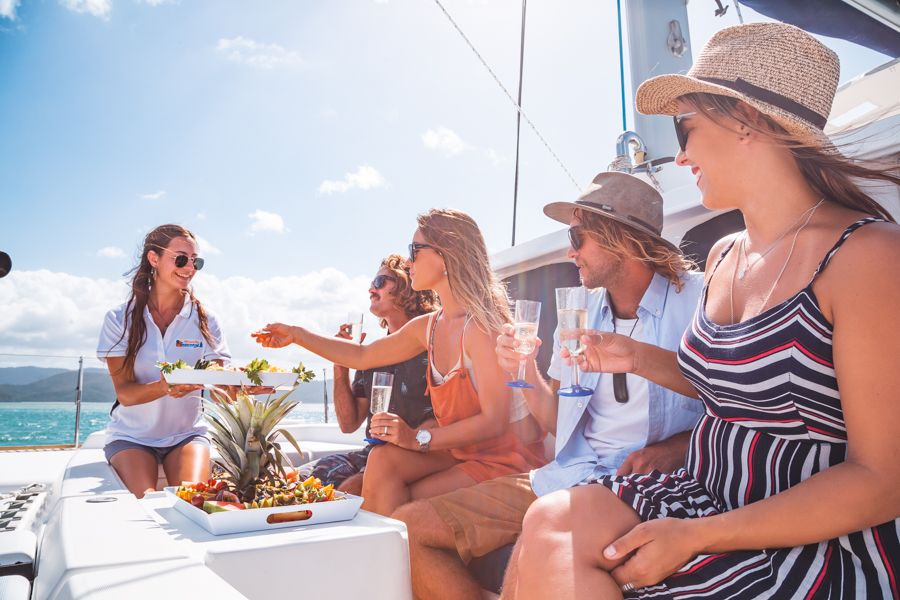 Crew offering fresh food to guests, Whitsundays, Australia
