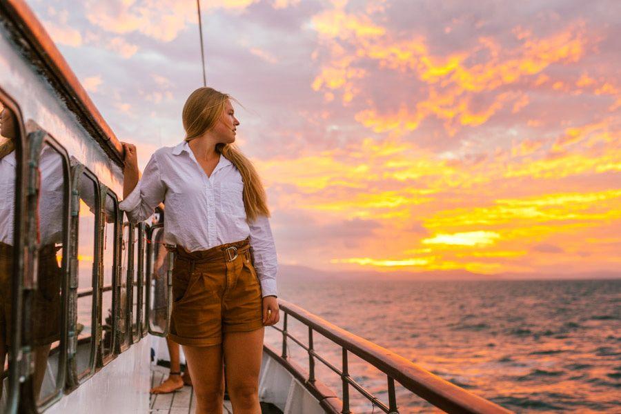 Girl looking the sunset, Whitsundays, Australia